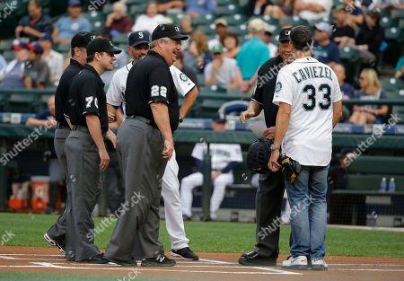 Jim Caviezel Actor Jim Caviezel, right, joins in on the pre-game coaches and umpires meeting at the plate after Caviezel threw out the first pitch of a baseball game between the Seattle Mariners and the Detroit Tigers, in Seattle