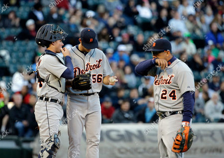 Kyle Ryan, James McCann, Miguel Cabrera Detroit Tigers starter Kyle Ryan, center, listens to catcher James McCann as first baseman Miguel Cabrera wipes his face during the first inning of a baseball game against the Chicago White Sox, in Chicago