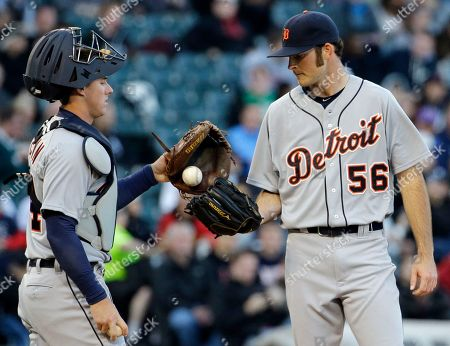 Kyle Ryan, James McCann Detroit Tigers starter Kyle Ryan, right, get a ball from catcher James McCann during the first inning of a baseball game against the Chicago White Sox, in Chicago