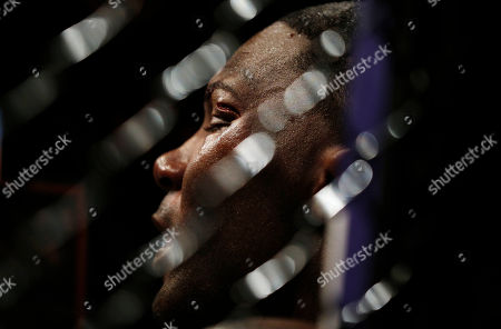 Daniel Cormier, Anthony Johnson Anthony Johnson sits on the mat with a cut above his eye after losing to Daniel Cormier during their light heavyweight title bout at UFC 187, in Las Vegas
