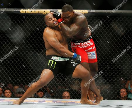 Daniel Cormier, Anthony Johnson Daniel Cormier, left, and Anthony Johnson duel in the light heavyweight mixed martial arts title bout at UFC 187, in Las Vegas