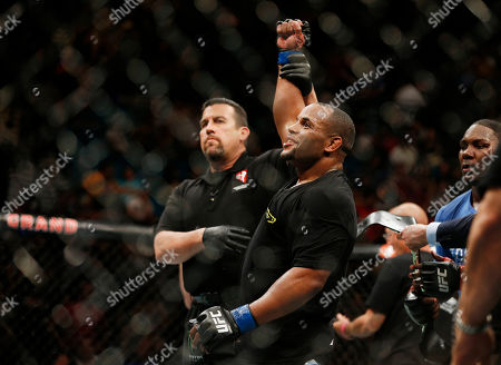 Daniel Cormier Daniel Cormier smiles after defeating Anthony Johnson in their light heavyweight mixed martial arts title bout at UFC 187, in Las Vegas