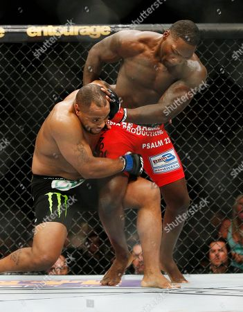 Daniel Cormier, Anthony Johnson Daniel Cormier, left, and Anthony Johnson compete in a light heavyweight title mixed martial arts bout at UFC 187, in Las Vegas