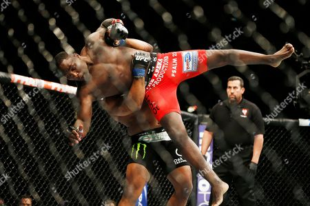 Daniel Cormier, Anthony Johnson Daniel Cormier lifts Anthony Johnson during their light heavyweight mixed martial art title bout at UFC 187, in Las Vegas