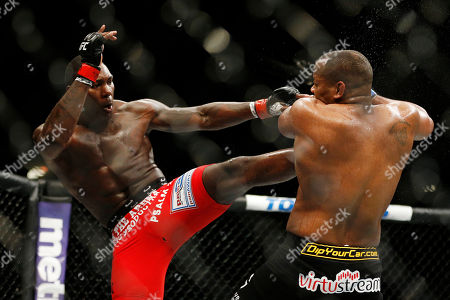 Daniel Cormier, Anthony Johnson Anthony Johnson kicks Daniel Cormier during their light heavyweight title mixed martial arts bout at UFC 187, in Las Vegas
