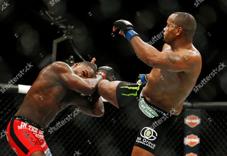 Daniel Cormier, Anthony Johnson Daniel Cormier kicks Anthony Johnson during their light heavyweight title mixed martial arts bout at UFC 187, in Las Vegas