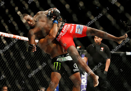 Daniel Cormier, Anthony Johnson Daniel Cormier lifts Anthony Johnson into the air during their light heavyweight title bout at UFC 187, in Las Vegas