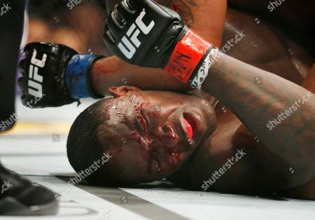Anthony Johnson, Daniel Cormier Anthony Johnson gets pounded by Daniel Cormier during their light heavyweight title mixed martial arts bout at UFC 187, in Las Vegas
