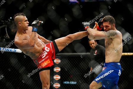 Chris Weidman, Vitor Belfort Vitor Belfort kicks Chris Weidman during their middleweight mixed martial arts bout at UFC 187, in Las Vegas
