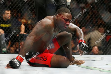 Daniel Cormier, Anthony Johnson Anthony Johnson sits on the mat after the second round in a light heavyweight title mixed martial arts bout against Daniel Cormier at UFC 187, in Las Vegas