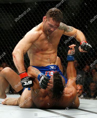 Chris Weidman, Vitor Belfort Chris Weidman pounds Vitor Belfort during their middleweight mixed martial arts bout at UFC 187, in Las Vegas