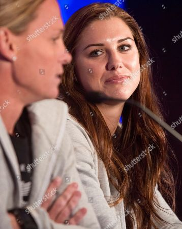 Women's World Cup United States forward Alex Morgan, right, listens as defender Christie Rampone, left, speaks during the U.S. women's national team World Cup media day, in New York. The U.S. will face South Korea on Saturday, May 30, at Red Bull Arena in their final send-off match, before leaving for Canada and the 2015 FIFA Women's World Cup