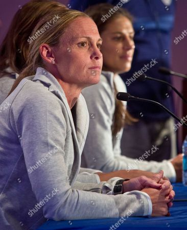 Women's World Cup U.S. women's soccer players Christie Rampone, left, and Carli Lloyd, right, listens during U.S. Women's National Team World Cup media day, in New York. The U.S. women will face South Korea on Saturday, May 30 at Red Bull Arena in their final send-off match, before leaving for Canada and the 2015 FIFA Women's World Cup