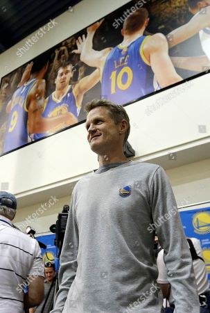 Steve Kerr Golden State Warriors head coach Steve Kerr walks under a photograph of Warriors forward Andre Iguodala (9), center Andrew Bogut and forward David Lee after speaking to reporters at the team's practice facility in Oakland, Calif., . The Warriors believe their first title in 40 years could be the first of many more. With their young core signed long-term and MVP Stephen Curry just entering his prime, the Warriors are certainly set up to make several championship runs