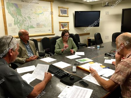 Mary Price, John Carter, John Tubbs, Tim Davis Mary Price, second from right, a scientist with the Confederated Salish and Kootenai Tribes, details the types of water rights included in paperwork filed with the Montana Department of Natural Resources and Conservation, in Helena, Mont., while CSKT attorney John Carter, second from left, DNRC director John Tubbs, left, and DNRC water resources division administrator Tim Davis listen