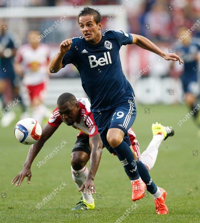Stock Photo of Octavio Rivero, Ronald Zubar Vancouver Whitecaps FC forward Octavio Rivero, front, beats New York Red Bulls defender Ronald Zubar to the ball during the first half of an MLS soccer match, in Harrison, N.J