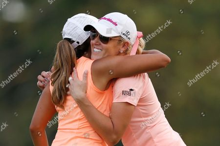 Cheyenne Woods, Natalie Gulbis Cheyenne Woods, left, and Natalie Gulbis hug on the ninth hole green after they finished the first round of the KPMG Women's PGA golf championship at Westchester Country Club, in Harrison, N.Y