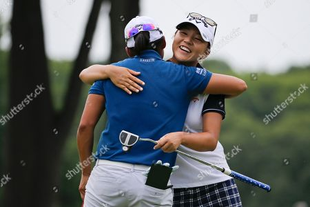 Lydia Ko Lydia Ko, of New Zealand, hugs Taiwan's Yani Tseng at the ninth hole during a practice round for the U.S. Women's Open golf tournament at Lancaster Country Club, in Lancaster, Pa