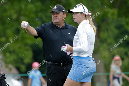 Stock Image of Paula Creamer Paula Creamer and her swing coach David Whelan, left, talk at the 11th hole during a practice round for the U.S. Women's Open golf tournament at Lancaster Country Club, in Lancaster, Pa