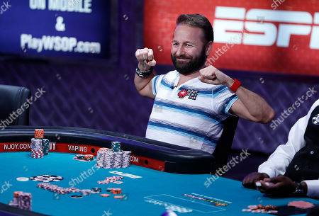 Daniel Negreanu stretches while playing at the World Series of Poker main event, in Las Vegas