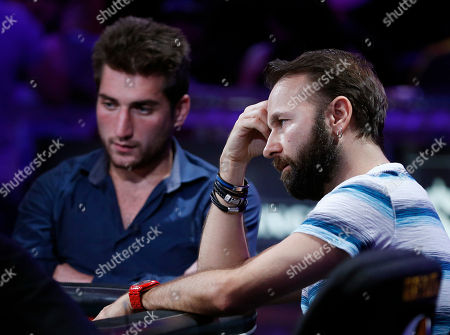 Daniel Negreanu, right, and Federico Butteroni compete at the World Series of Poker main event, in Las Vegas