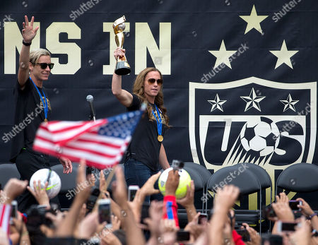 Christie Rampone, Abby Wambach U.S. women's soccer team captain Christie Rampone, center, and forward Abby Wambach acknowledge fans as they arrive to celebrate the team's World Cup championship, in Los Angeles. This was the first U.S. stop for the team since beating Japan in the Women's World Cup final Sunday in Canada