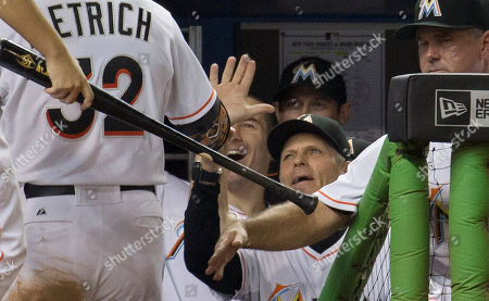 Brett Butler Miami Marlins coach Brett Butler (2) celebrates with Miami Marlins' Derek Dietrich (32) after his home run during the seventh inning of a baseball game against the New York Yankees in Miami, . The Marlins won 2-1
