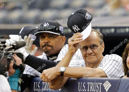 Joe Torre Joe Torre tips his cap to Willie Randolph as Randolph speaks during opening ceremonies for the Old-Timers' Day baseball game, at Yankee Stadium in New York
