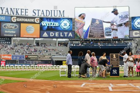 Willie Randolph Willie Randolph admires his plaque s his family watches him during opening ceremonies for the Old-Timers' Day baseball game, at Yankee Stadium in New York