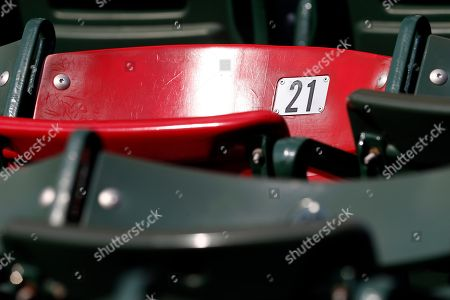 The red seat in the right field bleachers which marks the distance of former Boston Red Sox great Ted Williams home run is seen before a baseball game between the Red Sox and the New York Yankees in Boston