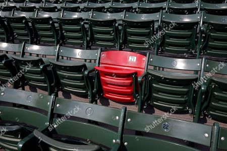 The red seat in the right field bleachers which marks the distance of a Ted Williams home run is seen before a baseball game between the Boston Red Sox and the New York Yankees in Boston