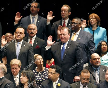 Patrick Daley Thompson, Katie Thompson Patrick Daley Thompson, front right, takes the oath of office for alderman, while his wife Katie, seated, watches during city government inaugural ceremonies, in Chicago. Thompson is taking his place on the City Council that his grandfather, Richard J. Daley, and his uncle, Richard M. Daley presided over and dominated for decades