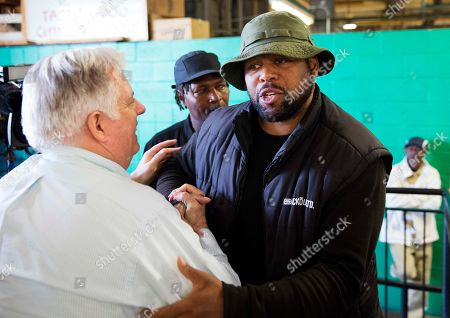 Larry Hogan, Andre Torrence, Rolando Fisher Maryland Gov. Larry Hogan, left, is greeted by Andre Torrence, right, and Rolando Fisher, rear, while visiting with local businesses, in Baltimore, in the area affected by the rioting following Monday's funeral for Freddie Gray, who died in police custody