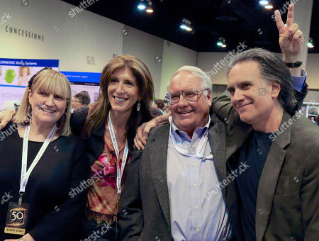 Stock Photo of Peter Buffett, Howard Buffett, Susie Buffett, Frances Dilorinzo The children of Warren Buffett, Susie Buffett, left, Howard Buffett, second right, and Peter Buffett, right, pose for a photo with comedian Frances Dilorinzo, second left, in the exhibit hall of the CenturyLink Center in Omaha, Neb., where Berkshire Hathaway subsidiaries were displaying their wares. Warren Buffett will mark 50 years of leading Berkshire Hathaway just like he has at past annual meetings: by spending several hours on Saturday answering any and all questions. More than 40,000 people are expected to attend the shareholders meeting this year