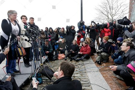 Boston Marathon bombing survivor Karen Brassard, left, speaks outside federal court alongside Laurie Scher, second from left, and Mike Ward, third from left, in Boston where Dzhokhar Tsarnaev was convicted on multiple charges in the 2013 Boston Marathon bombing. Three people were killed and more than 260 were injured when twin pressure-cooker bombs exploded near the finish line