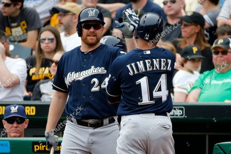 JoLuis Jimenez, Adam Lind Milwaukee Brewers' Luis Jimenez (14) is greeted by teammate Adam Lind (24) after scoring on a single by Brewers' Jonathan Lucroy off Pittsburgh Pirates starting pitcher Gerrit Cole in the second inning of a baseball game in Pittsburgh, . The Pirates won 5-2