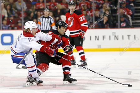Jacob De La Rose, Scott Gomez Montreal Canadiens left wing Jacob De La Rose, left, of Sweden, and New Jersey Devils center Scott Gomez compete for the puck during the second period of an NHL hockey game, in Newark, N.J