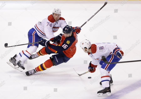 Brandon Prust, Alexei Emelin, Aleksander Barkov Florida Panthers center Aleksander Barkov (16) of Finland, battles for the puck with Montreal Canadiens defenseman Alexei Emelin (74) of Russia, and right wing Brandon Prust (8) during the first period of an NHL hockey game, in Sunrise, Fla