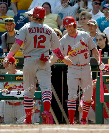 Mark Reynolds, Peter Bourjos St. Louis Cardinals' Mark Reynolds (12) is greeted by Peter Bourjos (8) after scoring from third on a hit by Jason Heyward in the seventh inning of a baseball game, in Pittsburgh. The Pirates won 4-3