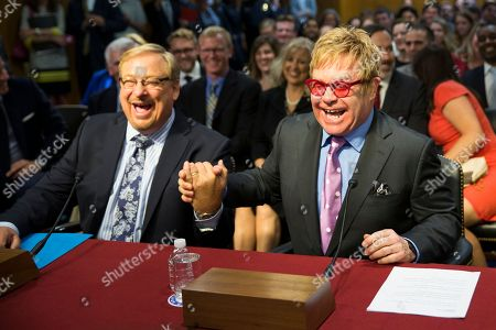 Elton John, Rick Warren Musician Sir Elton John, right, greets Dr. Rick Warren on Capitol Hill in Washington, prior to testifying before the Senate State, Foreign Operations, and Related Programs subcommittee in support of U.S. funding for global HIV/AIDS treatment