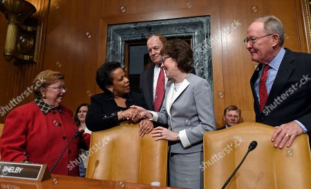Loretta Lynch, Barbara Milulski, Richard Shelby, Susan Collins, Lamar Alexander Attorney General Loretta Lynch, center, is welcomed on Capitol Hill in Washington, prior to testifying before the Senate subcommittee on Commerce, Justice, Science, and Related Agencies hearing to examine the proposed budget estimates for fiscal year 2016 for the Justice Department. From left are, the subcommittee's ranking member Sen. Barbara Mikulski, D-Md., Lynch, subcommittee Chairman Sen. Richard Shelby, R-Ala, Sen. Susan Collins, R-Maine and Sen. Lamar Alexander, R-Tenn
