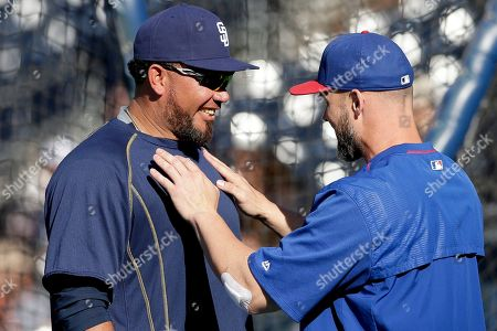 Joaquin Benoit, David Ross San Diego Padres relief pitcher Joaquin Benoit, left, jokes with Chicago Cubs catcher David Ross before a baseball game, in San Diego