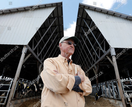 David Wood Dairy farmer David Wood poses at Eildon Tweed Farm in West Charlton, N.Y. Wood says he's currently selling milk for less than it costs to produce it, but he hopes prices will recover in the fall
