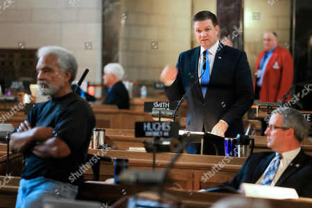 Beau McCoy, Ernie Chambers, Dan Hughes State Sen. Beau McCoy, center, of Omaha, speaks during second-round debate, at the Legislature in Lincoln, Neb., on a bill to abolish the death penalty, as state Sens. Ernie Chambers of Omaha, left, and Dan Hughes of Venango, right, listen