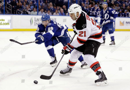 Scott Gomez, Nikita Nesterov New Jersey Devils center Scott Gomez (21) gets around Tampa Bay Lightning defenseman Nikita Nesterov (89), of Russia, during the third period of an NHL hockey game, in Tampa, Fla. The Lightning won 4-3 in overtime