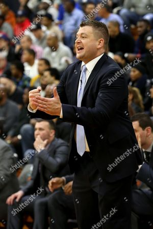 Stock Picture of Andy Johnson Findlay Prep head coach Andy Johnson works the sideline against Montverde Academy in the DICK'S Sporting Goods High School National Basketball Tournament on in Queens, NY