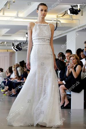 A model wears a creation from the Oscar de la Renta Bridal Spring 2016 collection in New York. Peter Copping, hired last October as artistic director of the luxury label, retained much of the classic de la Renta glamour but added a few more modern-looking silhouettes, some new takes on fabric work, and some silvery sequins