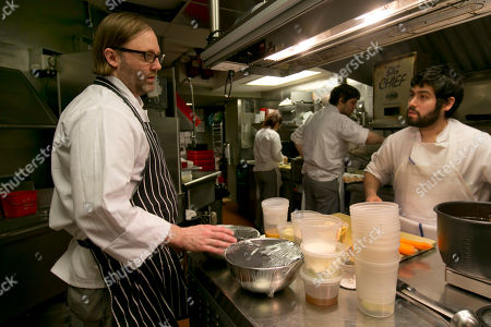 Wylie Dufresne Chef Wylie Dufresne, left, talks with a member of his kitchen staff, at his restaurant Alder, in New York