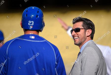 Adrian Gonzalez, Nomar Garciaparra Los Angeles Dodgers' Adrian Gonzalez, left, talks with former player Nomar Garciaparra during batting practice prior to a baseball game against the San Francisco Giants, in Los Angeles