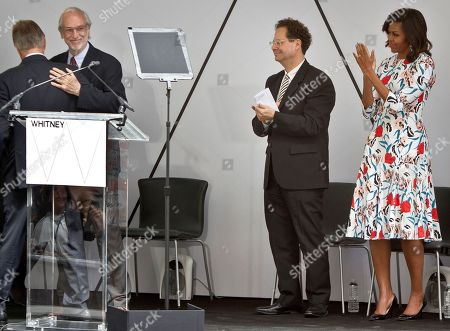 Michelle Obama, Adam Weinberg, Renzo Piano First lady Michelle Obama, far right, and Adam Weinberg, second from right, director of the Whitney Museum of Art, applaud as Renzo Piano, second from left, prepares to speak during a ribbon-cutting ceremony for the new $422 million Whitney Museum of American Art he designed, in New York